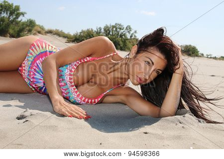beautiful woman lying on the sand