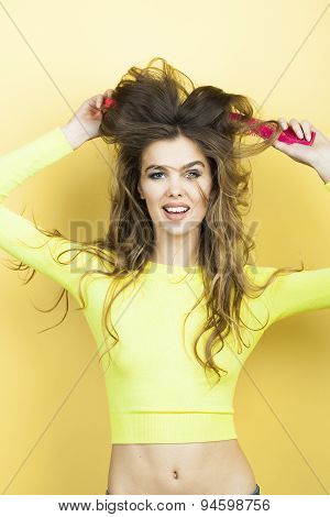Smiling Woman With Hair Brushes