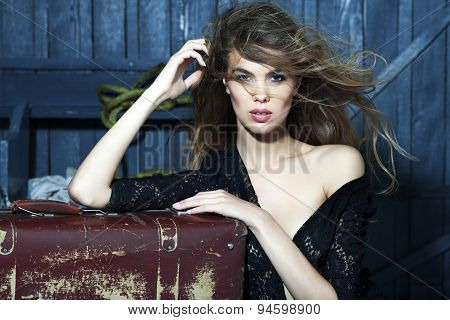 Passionate Woman In Garage With Suitcase