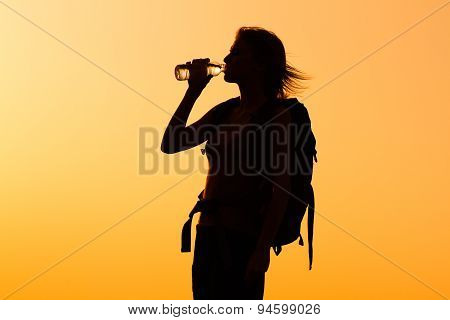 Refreshment for woman hiker