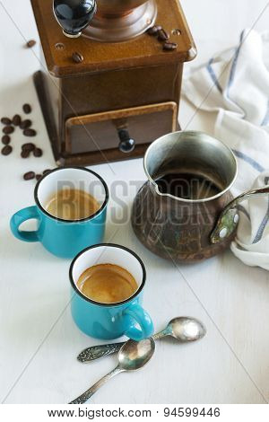 Cups Of Coffee, Coffee Pot And Coffee Grinder.