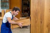 image of dungarees  - worker in blue dungarees in a carpenter - JPG