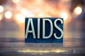 image of std  - The word AIDS written in vintage metal letterpress type on a soft backlit background - JPG