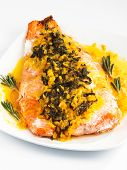 foto of saffron  - Salmon with sauce of saffron onion and rosemary served in white plate - JPG
