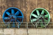 image of ventilator  - Two giant colored ventilators in the facade of an industrial building - JPG