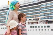 picture of cruise ship  - mother son and daughter in dock looking right big cruise ship on background