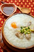 stock photo of porridge  - porridge with egg and liver traditional chinese food - JPG