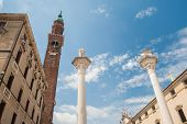image of vicenza  - View of the two columns and some typical palaces in the main square of Vicenza - JPG