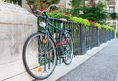 picture of vicenza  - Roadster bike parked by the railing of Saint Paul bridge in Vicenza - JPG