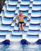 foto of toboggan  - Senior man enjoying holiday in aqua park - JPG