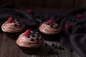 image of chocolate muffin  - Traditional homemade Chocolate Cupcakes or muffins sweet dessert with wheeped cream - JPG