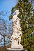 stock photo of garden sculpture  - Garden sculpture of a woman with a sword - JPG