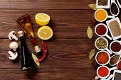 stock photo of condiment  - Various spices and condiments on wooden background with copy space - JPG