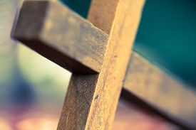 picture of christianity  - A macro closeup of a wooden Christian cross laying at an angle - JPG