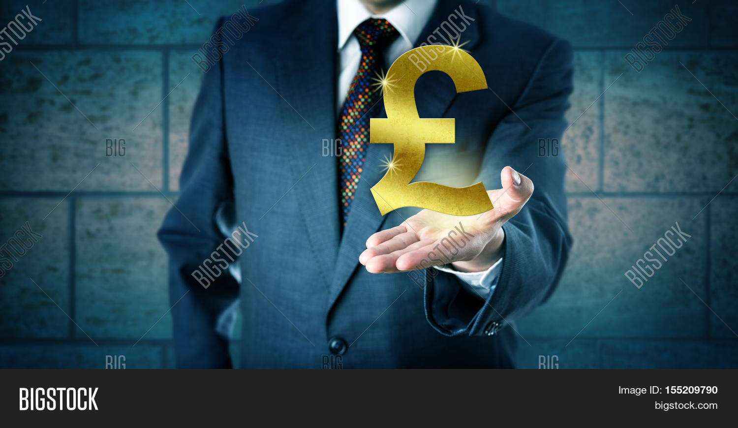 Forex trader holding golden british image photo bigstock forex trader holding a golden british pound sterling symbol in the open palm of his left biocorpaavc Gallery