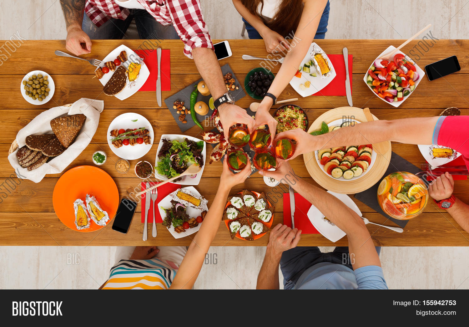 Dinner table top view - People Clink Glasses Saying Cheers Eat Healthy Meals At Party Dinner Table Friends