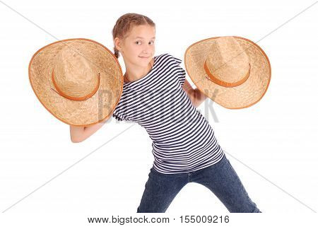Pretty twelve year old girls wearing a big floppy straw sun hat isolated on white