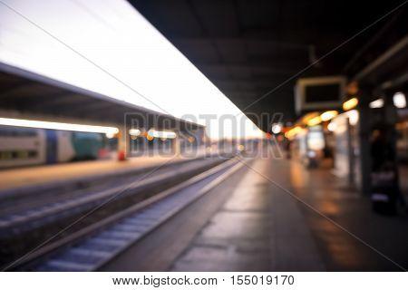 Blurred train station - De focused image - Concept about transport and traveler
