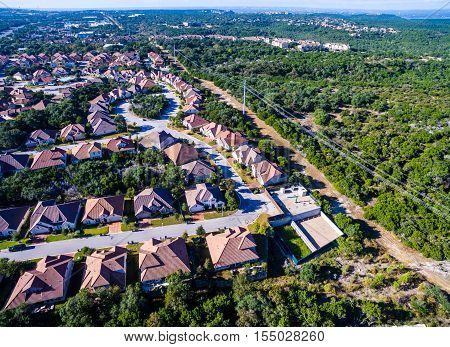 West Lake Austin Texas Houses New Development at the Suburb with rooftop houses and streets surrounded by Green Texas hill Country