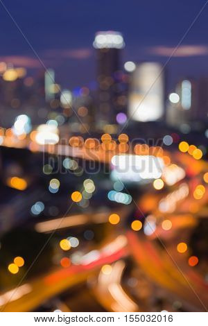 Blurred light highway interchanged with office building background