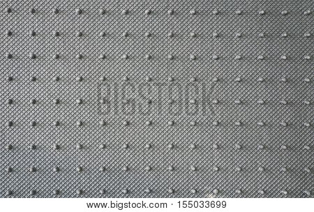 Back view of knobby car mat non slip rubber surface texture background