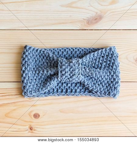 Headband Gray-blue Color Knit Hand On Wooden Backgroundheadband Gray-blue Color Knit Hand On Wooden