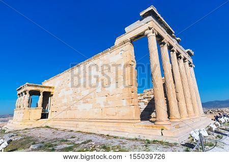 Acropolis, Erechtheum Temple in Athens, Greece and blue sky