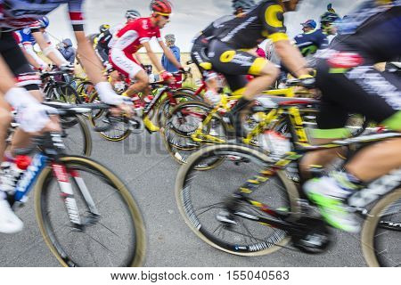 Ardevon France - July 2 2016: Abstract blurred image of the peloton taking the start of Tour de France at Km 0 close to Mont Saint Michel Monastery in ArdevonFrance on July 22016.