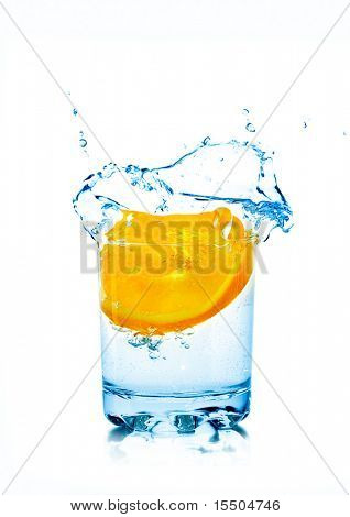 Orange fall in glass with water