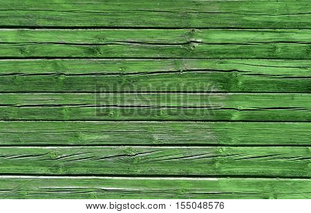 Weathered Green Color Log House Wall.