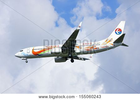 Chiangmai, Thailand - October 1, 2014: B-1907 Boeing 737-800 of China Eastern Airline. Landing to Chiangmai Airport from Kunming.