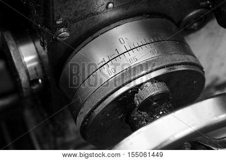 Part of lathe close-up. Black and white image