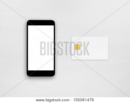 Smartphone and credit card on white table top view
