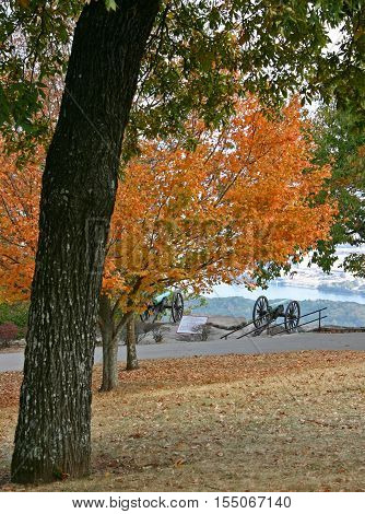 a Civil War cannon overlooks Chattanooga, Tennessee, from Lookout Mountain, amid autumn foliage