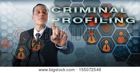 Computer forensic investigator is touching CRIMINAL PROFILING on an interactive screen. Information technology concept and law enforcement metaphor for offender profiling and criminal investigation.