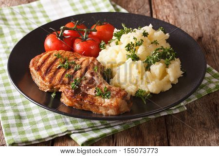 Grilled Pork T-bone Steak Garnished With Mashed Potatoes Close-up. Horizontal
