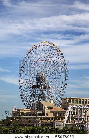 YOKOHAMA, JAPAN - OCTOBER 6, 2016: Cosmo Clock 21 ferris wheel in Yokohama Japan. When it first opened at 1989 it was the world's tallest Ferris wheel