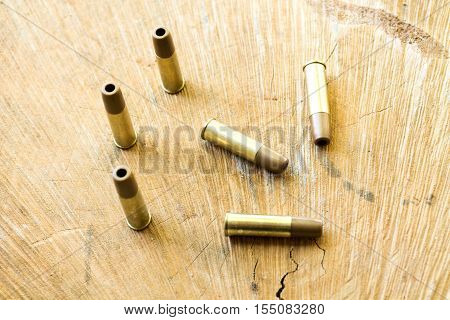 Bullets. Pneumatic bullets. The bullets on the wooden background.