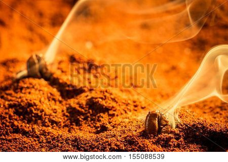 Roasted coffee smell good on brown background