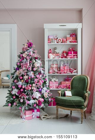 Interior room decorated in Christmas style. No people. An empty chair. Neutral colors. Home comfort of modern home