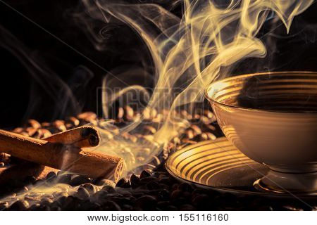 Cinnamon smell of fresh brewed coffee on black background