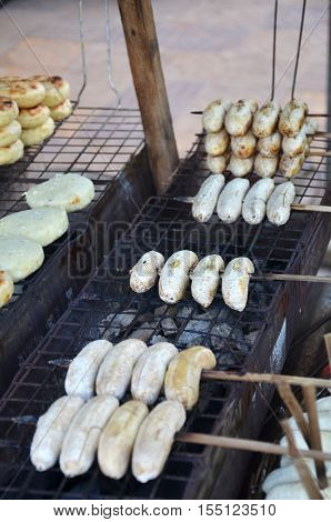 Sweet grilled bananas at asian food market in Cambodia