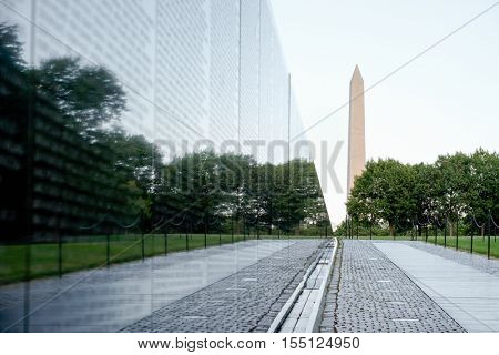 WASHINGTON D.C.,USA - AUGUST 14,2016 : The Vietnam Veterans Memorial in Washington D.C. with the Washington Monument on the background