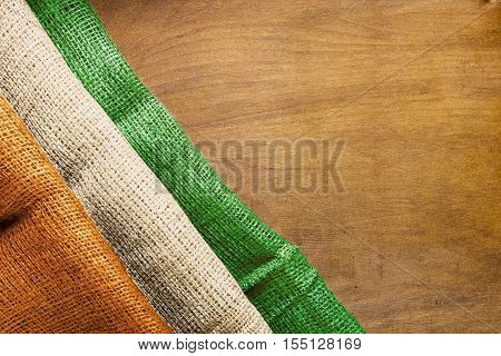 State Flag Coast Ivory on a wooden background.