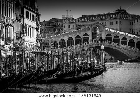 Venice Italy - August 13 2016: Venice Italy. Rialto bringe on Grand canal. Black and white photography