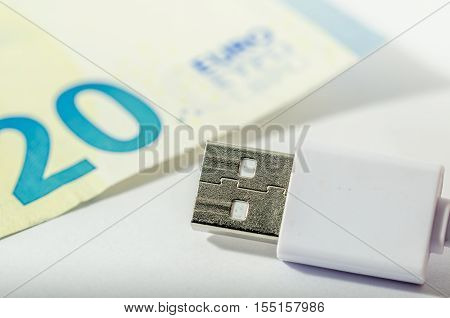 usb cables and euro bill. money and technology