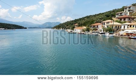 Meganisi island GREECE May 11 2013: View on the harbour and island with mountains in Vathi village. Meganisi island Ionian sea Greece.