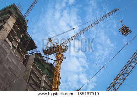 Crane in a construction site with blue sky background