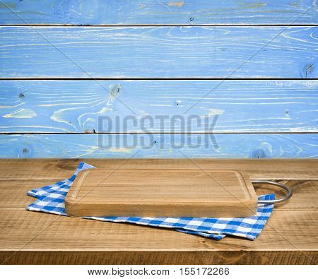 Cutting board kitchen towel on blue wooden background side view