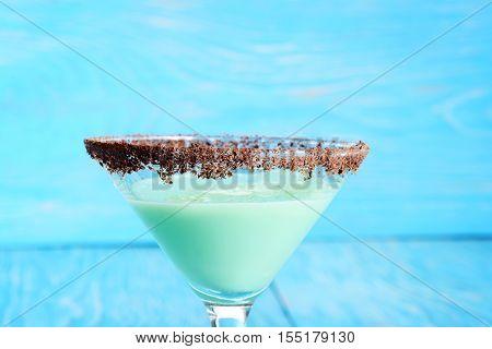 closeup chocolate grasshopper cocktail on blue background